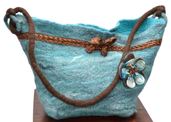 Merino and felt teal handbag with pearl shell brooch